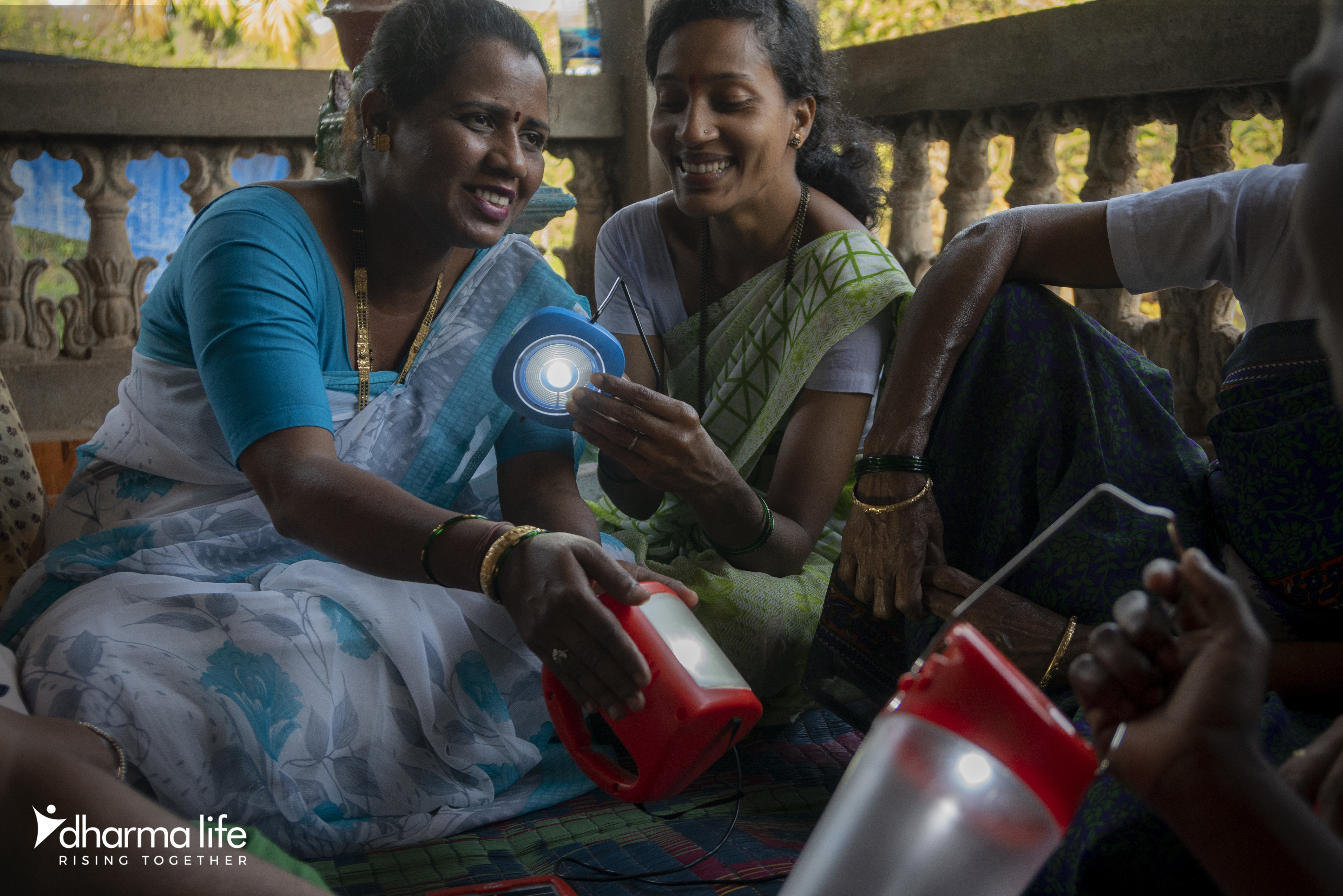 2 Indian ladies looking at solar lanterns