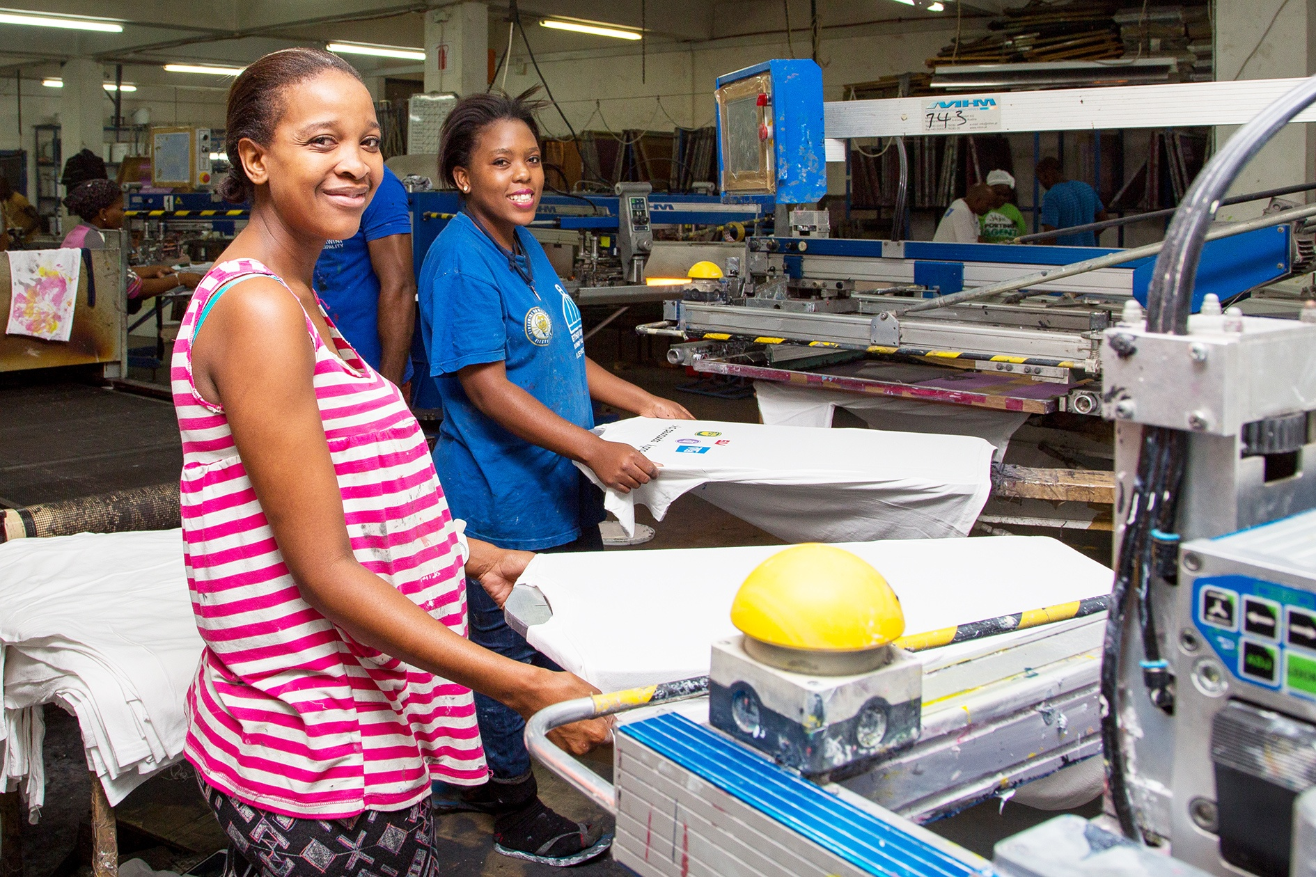 Two African ladies at work in a factory