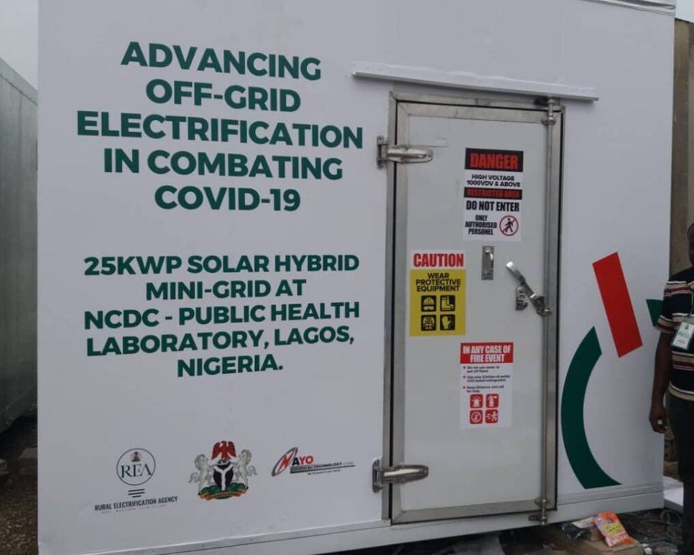 Electricity unit with text printed saying: Advancing off-grid electrification in combating covid-19